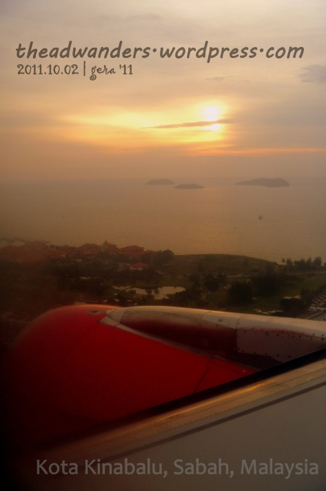 The Red of AirAsia over the orange sun setting at Kota Kinabalu