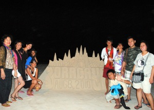 Family Group Shot by the Sand Castle