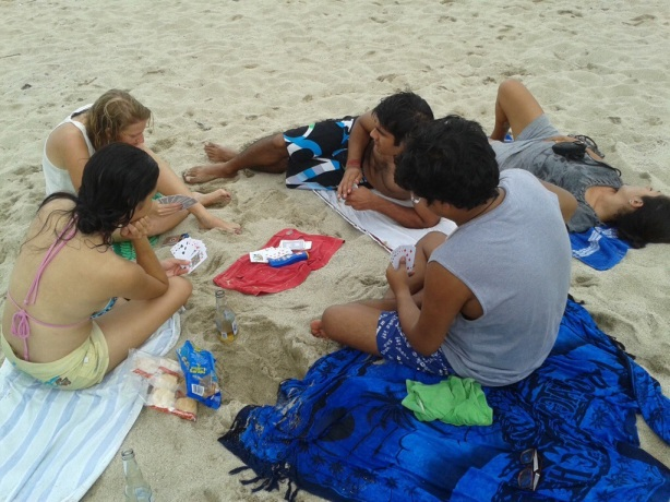 The gang's favorite beach past times: cards, beer and sleep!