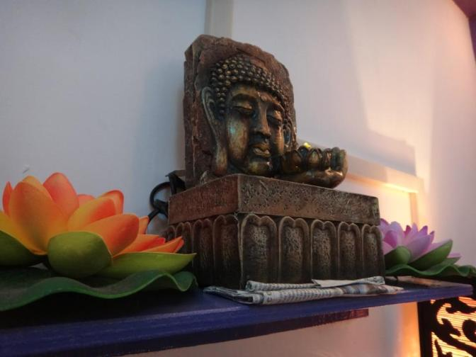 Buddha sculpture at Be Happy Cafe