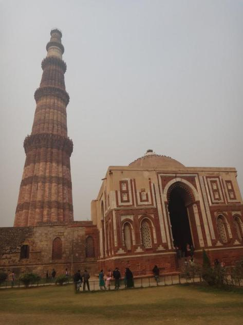 Qutb Minar and Alai Darwaza, entrance gate to the Quwwatu'l-Islam Mosque