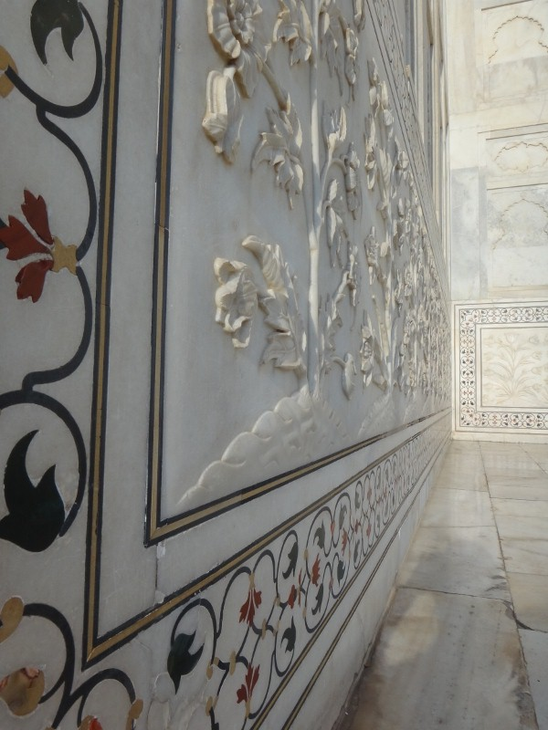 elaborately designed paintings and carvings