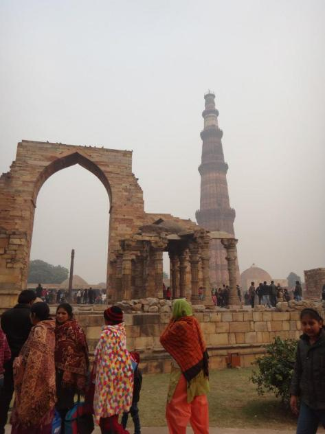Ruins of Quwwatu-ul-Islam Mosque with Qutub Minar at the background