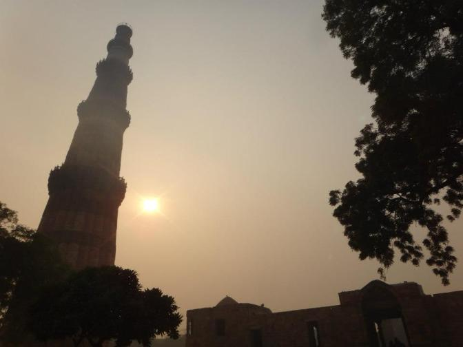 Tower of Victory and the Sun shining through the fog