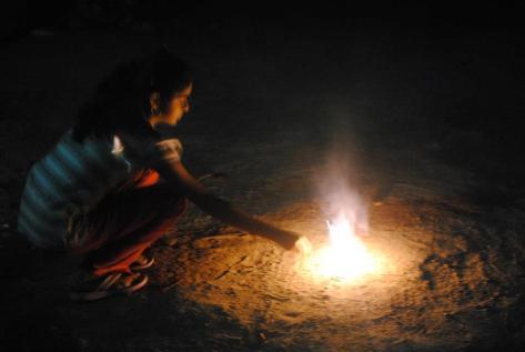 My landlady's daughter Pratiksha lighting firecrackers (Uncle and Auntie were supervising)